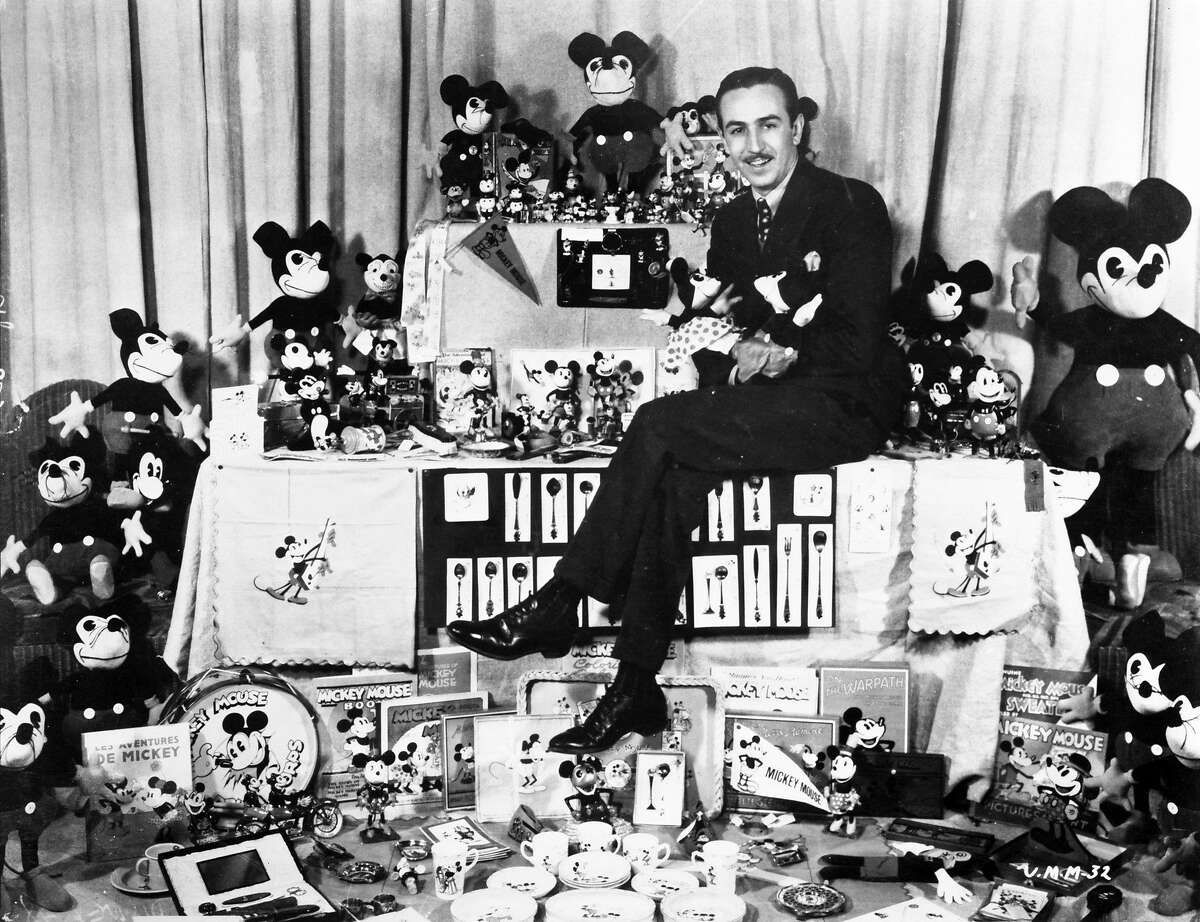 Walt Disney with Mickey Mouse merchandise, from