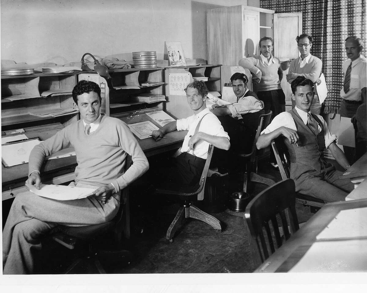 Walt Disney, center, rear, with some of his animators, from