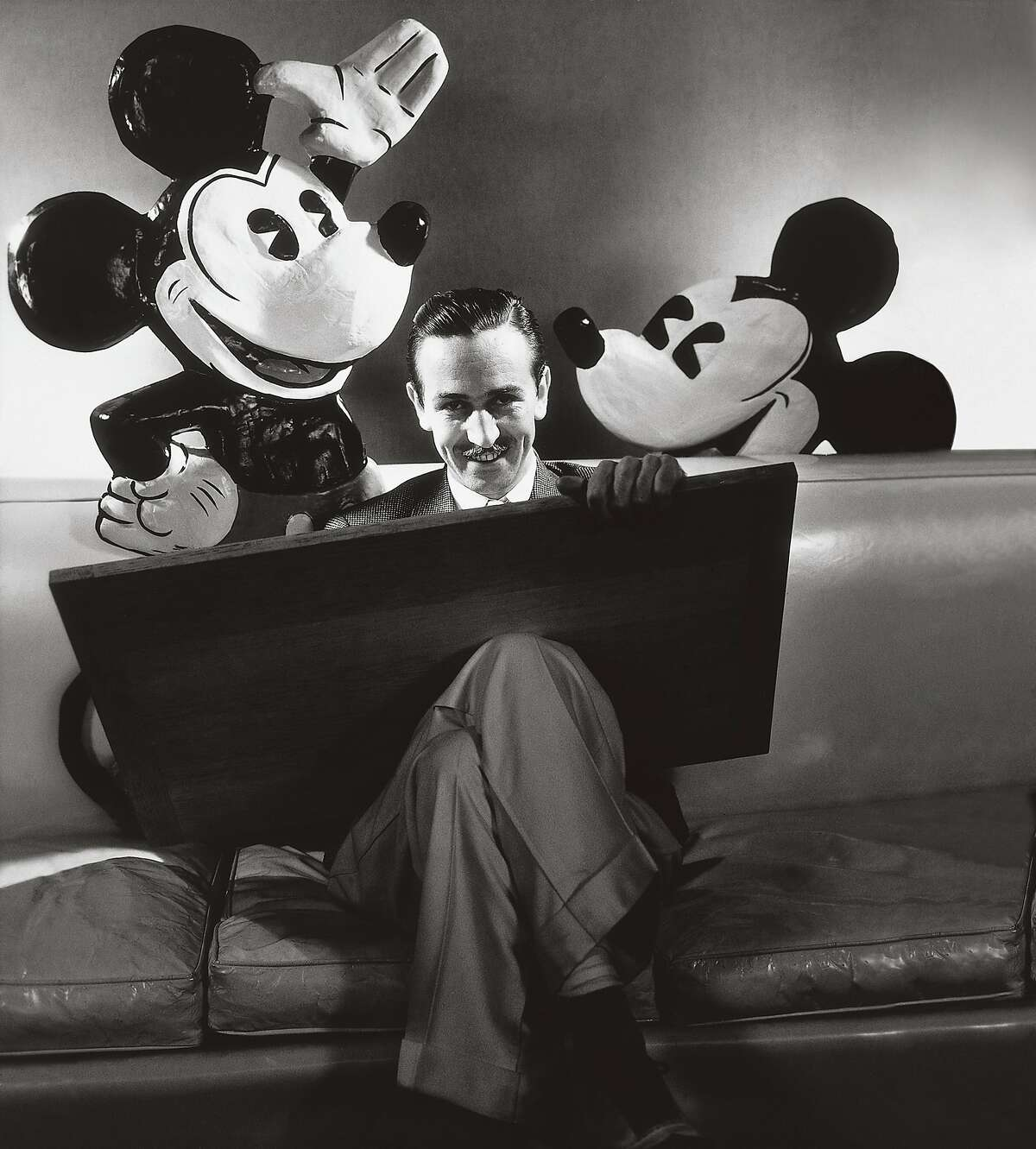 Walt Disney with his most famous creation, Mickey Mouse, from