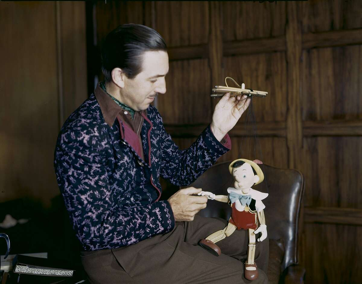 Walt Disney with a Pinocchio marionette from