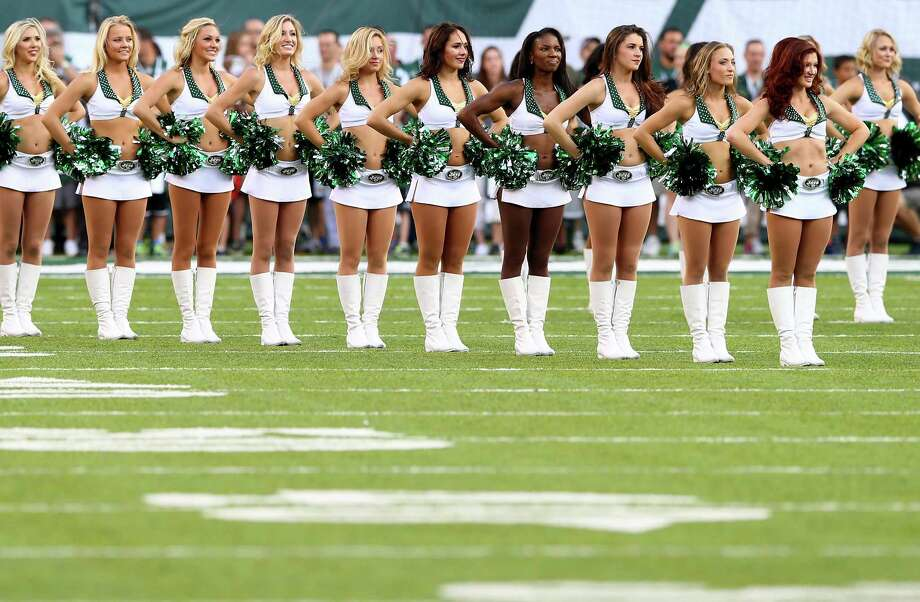 EAST RUTHERFORD, NJ - AUGUST 07: New York Jets cheerleaders perform prior to a preseason game against the Indianapolis Colts at MetLife Stadium on August 7, 2014 in East Rutherford, New Jersey.  (Photo by Elsa/Getty Images) ORG XMIT: 501328481 Photo: Elsa / 2014 Getty Images
