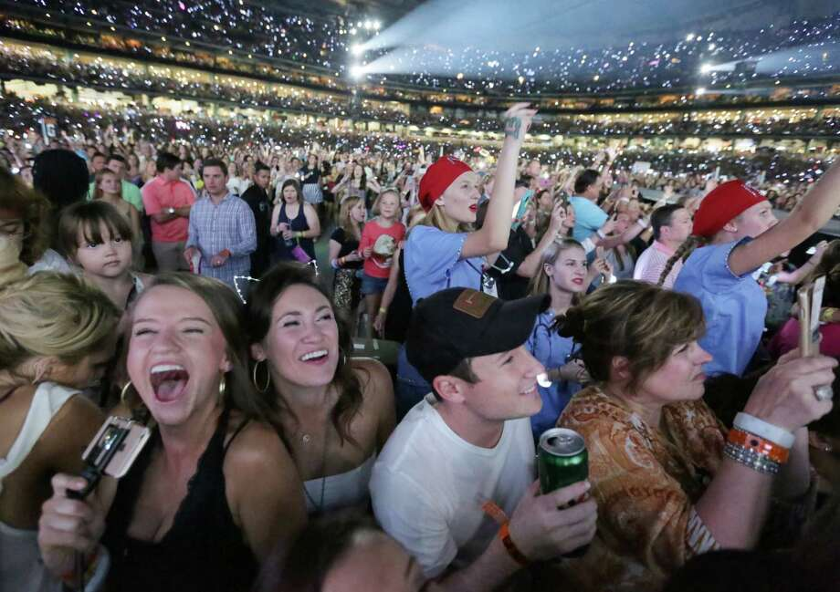 From left, Haley Teare, Natalie Cooke and J. D. Weinstein scream and cheer as Taylor Swift performs at Minute Maid Park, Wednesday, Sept. 9, 2015, in Houston. Photo: Jon Shapley, Houston Chronicle / © 2015 Houston Chronicle