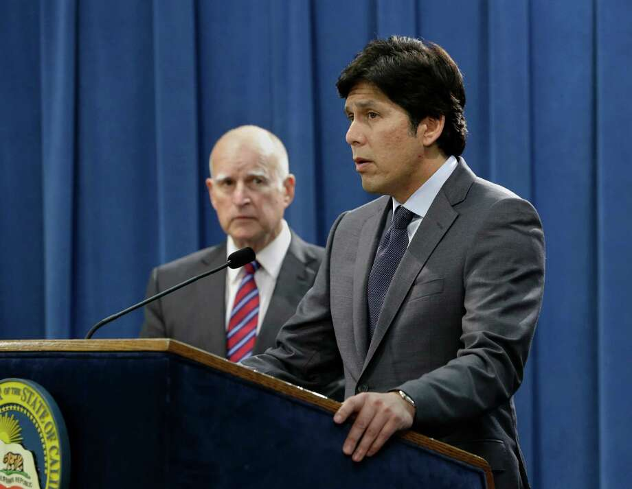 Senate President Pro Tem Kevin de Leon, D-Los Angeles, accompanied by Calif. Gov. Jerry Brown, left, and Assembly Speaker Toni Atkins, D-San Diego, unseen, announce he is scaling back a proposal to address climate change, during a news conference, Wednesday, Sept. 9, 2015, in Sacramento, Calif.  Citing opposition from the oil industry, de Leon said he was dropping a mandate in his bill, SB350, that the state cut petroleum use by 50 percent. Photo: Rich Pedroncelli, AP / AP