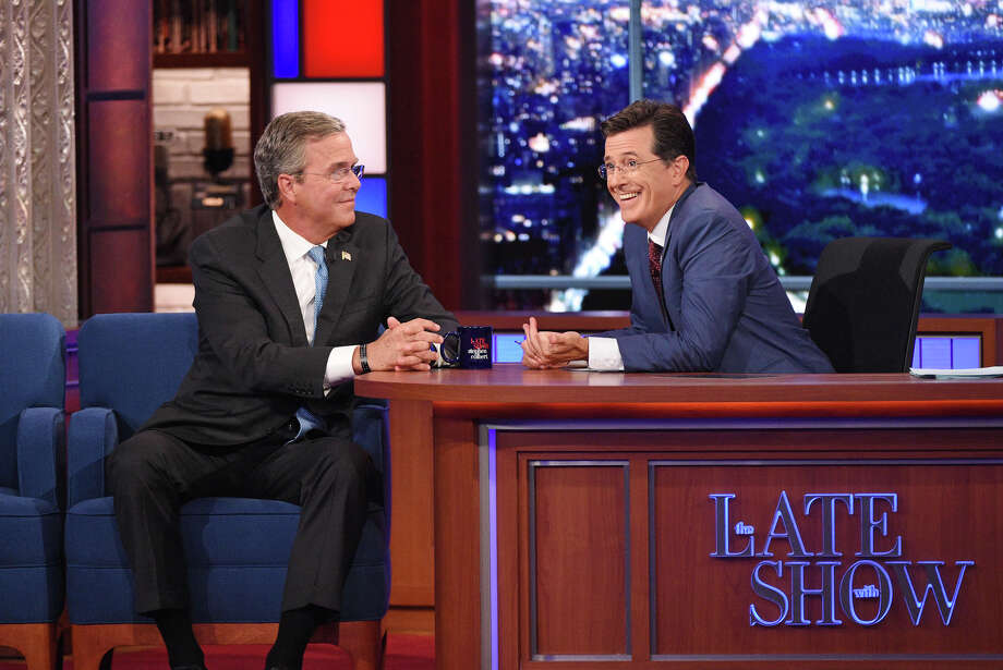 "Stephen Colbert, right, talks with Republican presidential candidate Jeb Bush during the premiere episode of ""The Late Show,"" Tuesday Sept. 8, 2015, in New York. Bush and actor George Clooney were the guests for Colbert's debut. (Jeffrey R. Staab/CBS via AP) ORG XMIT: NY109 Photo: Jeffrey R. Staab / ©2015 CBS Broadcasting Inc. All Rights Reserved"