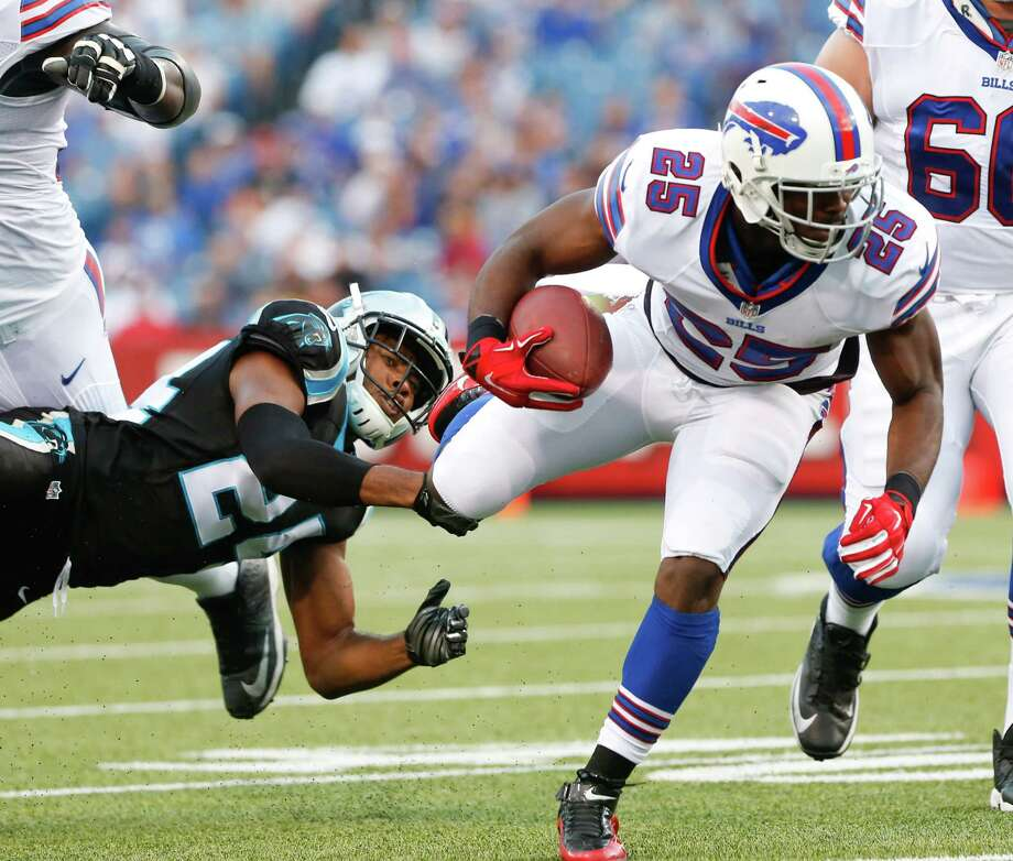 Buffalo Bills running back LeSean McCoy (25) is tripped up by Carolina Panthers cornerback Josh Norman (24) during the first half of an NFL preseason football game on Friday, Aug. 14, 2015, in Orchard Park, N.Y. (AP Photo/Heather Ainsworth)  ORG XMIT: NYMG108 Photo: Heather Ainsworth / FR120665 AP
