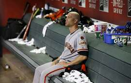 San Francisco Giants' Tim Hudson sits in the dugout during the seventh inning of a baseball game against the Arizona Diamondbacks Tuesday, Sept. 8, 2015, in Phoenix.  The Giants defeated the Diamondbacks 6-2. (AP Photo/Ross D. Franklin)