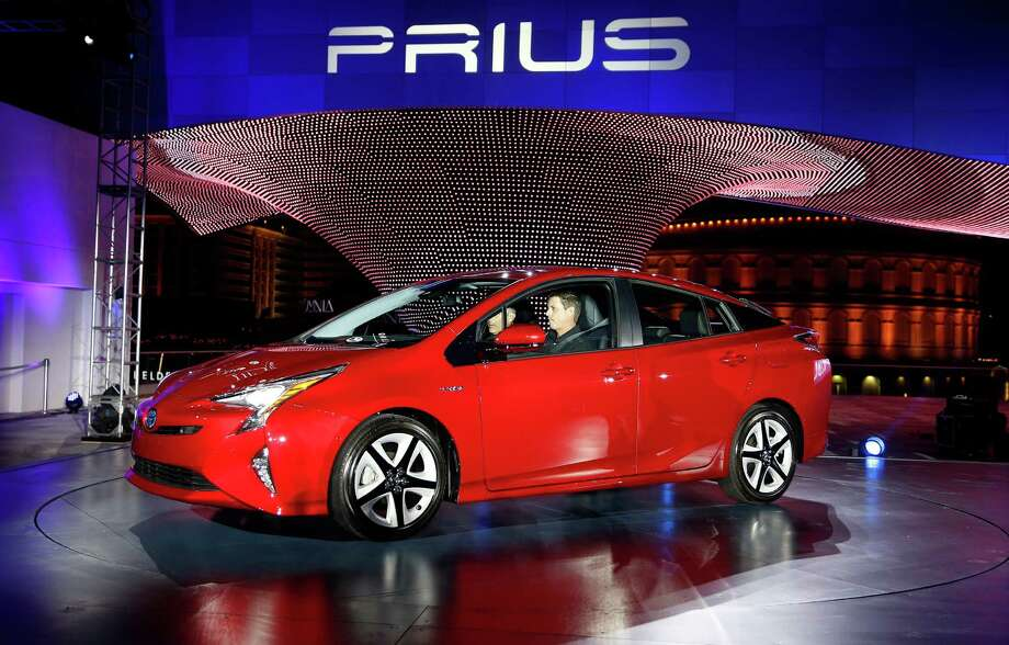 Toyota shows the latest version of the Prius in Las Vegas this week. The car is still the No. 1 hybrid. Photo: John Locher, STF / AP