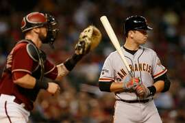 PHOENIX, AZ - SEPTEMBER 09:  Buster Posey #28 of the San Francisco Giants reacts as he is intentionally walked by the Arizona Diamondbacks during the seventh inning of the MLB game at Chase Field on September 9, 2015 in Phoenix, Arizona.  (Photo by Christian Petersen/Getty Images)