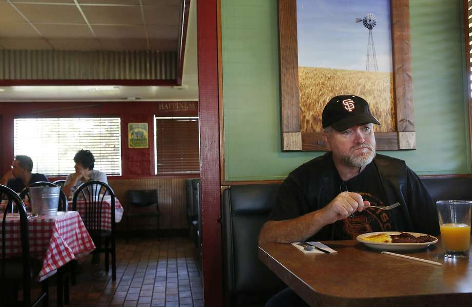 Baker has breakfast at Perko's Cafe in Tracy. Though he has senior water rights, he's lower on the pecking order of water rights than some larger neighboring farms and orchards. Photo: Leah Millis, The Chronicle