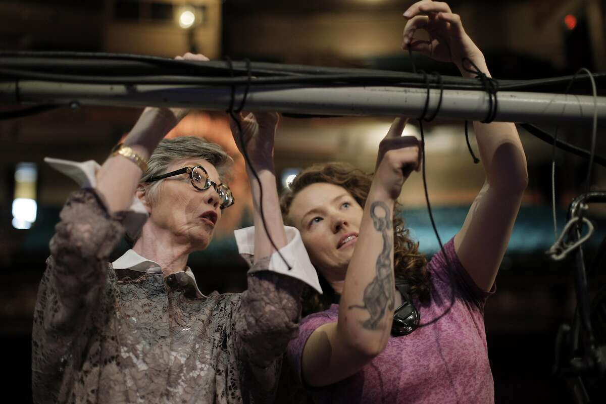 Krissy Kenny, lightboard operator, right, shows Carole Shorenstein Hays how to tie a clove hitch knot at the Curran Theater in San Francisco, Calif., on Wednesday, September 9, 2015. Shorentstein Hays owns the Curran and is in the process of having it renovated.