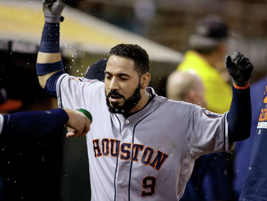 Marwin Gonzalez gets the water to the face treatment after his      seventh-inning home run gave the Astros four homers on the night. Photo: Ben Margot, STF / AP