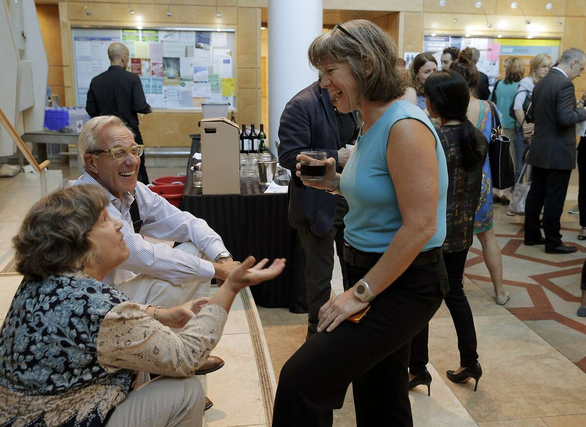 Jean Anne Booth CEO of UnaliWear, right, chats with Helynna Brooke, left, and Laurence Berger, center, at an Aging 2.0 event in San Francisco, Calif., where entrepreneurs pitched elder care innovation ideas at UCSF on Wednesday, September 9, 2015.