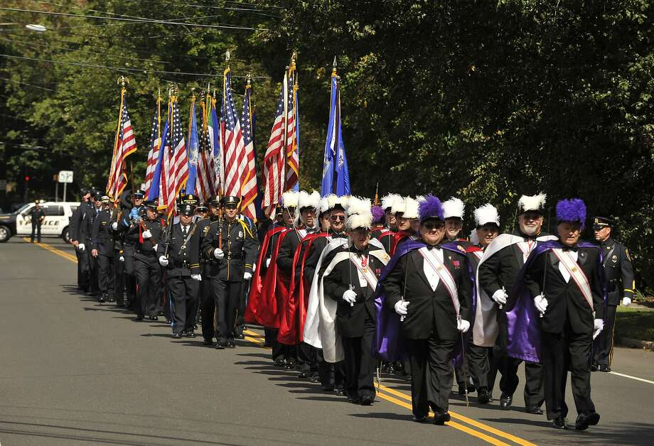 Members of the Knights of Columbus lead a contingent of first responders along France Street in Norwalk, Conn., prior to the start of Blue Mass honoring first responders at St. Philip Church in Norwalk, Conn., on Sunday, Sept. 15, 2013. Photo: Jason Rearick