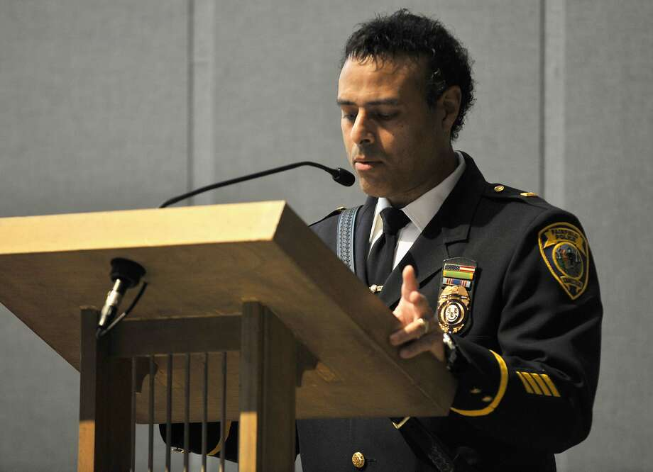 Lt. James Perez from the Fairfield Police Department gives the first reading during Blue Mass honoring first responders at St. Philip Church in Norwalk, Conn., on Sunday, Sept. 15, 2013. Photo: Jason Rearick