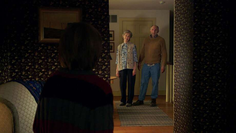 """In this image released by Universal Pictures, Deanna Dunagan, background left, and Peter McRobbie appear in a scene from """"The Visit."""" (Universal Pictures via AP) Photo: Associated Press / Universal Pictures"""