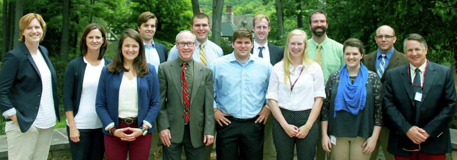 The Gunnery in Washington welcomes new faculty for the 2015-16 school year. New members include, from left to right, in front, Melissa Schomers, Suzanne Day, Lindsey Dirats, Michael Yurgeles, Shane Gorman, Hannah Gorman, Sarah Albright and Scott Schereschewsky, and, in back, Ian Boldt, Peter Ganem, Brian Konik and Christopher Ciarleglio. Photo: Courtesy Of The Gunnery / The News-Times Contributed