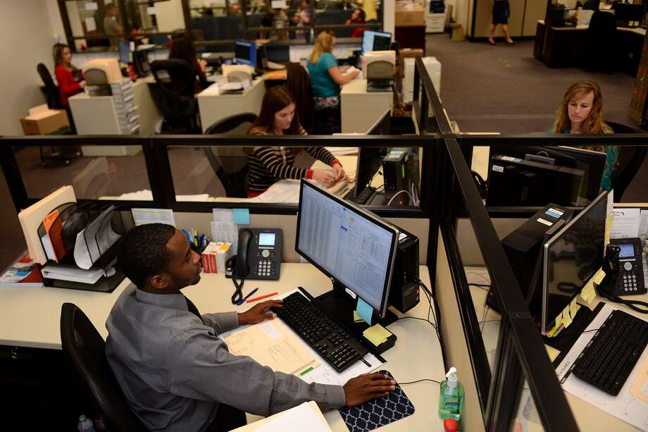 Clerks John Allen, Jennifer Kessinger, left, and Nicole Cano work on processing information to make dealing with the  Harris County Courthouse Humble Annex easier for citizens and other courts. Precinct 4, Place 2 Judge Laryssa Korduba said her pledge to bring better technology to the office is almost fulfilled. Photo: Jerry Baker, Freelance