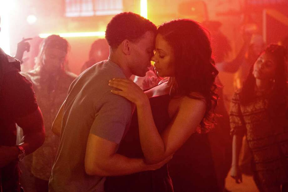Carter (Michael Ealy) takes Leah (Sanaa Lathan) on a date to a reggae club in Screen Gems' THE PERFECT GUY. Photo: Dan McFadden / © 2014 Columbia TriStar Marketing Group, Inc.  All rights reserved.  **ALL IMAGES ARE PROPERTY OF SONY PICTURES ENTERTAINMENT I