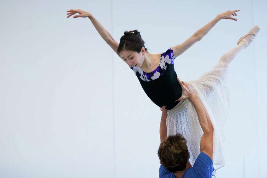 Houston Ballet first soloist Aaron Robison lifts principal dancer Yuriko Kajiya during a recent rehearsal. Kajiya has battled hip issues for the past 10 years. Photo: Marie D. De Jesus, Houston Chronicle / © 2015 Houston Chronicle