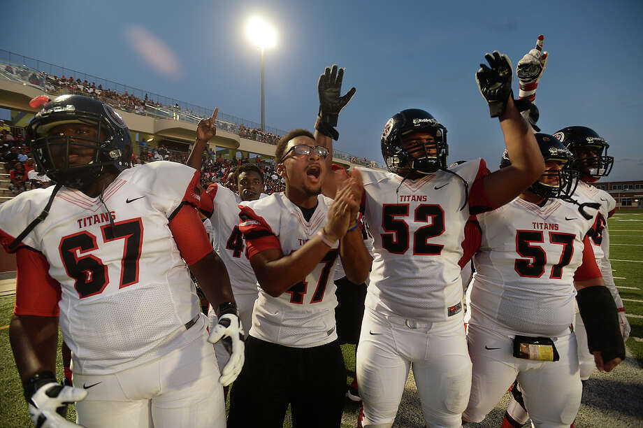 "Port Arthur Memorial's sideline celebrates as they cheer on the offense's advance over Central during their match-up Saturday at ""The Butch"" in Beaumont. Photo taken Saturday, September 5, 2015 Photo by Kim Brent Photo: Kim Brent / Beaumont Enterprise"