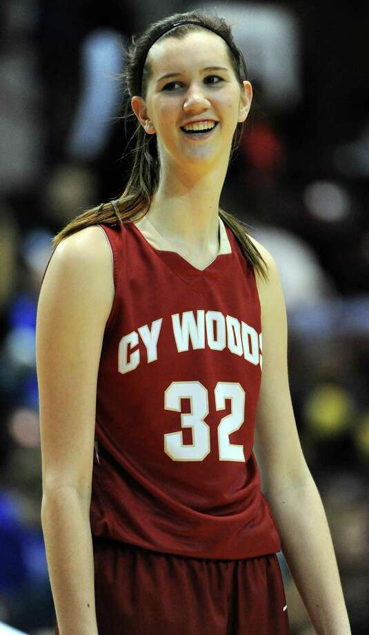 Up by thirty-two points at halftime, Cy-Woods center Nancy Mulkey smiles before the start of the second half during the Region III 6A final girls high school basketball game, Saturday, February 28, 2015, at Campbell Center in Houston. Photo: Eric Christian Smith, For The Chronicle / 2015 Eric Christian Smith