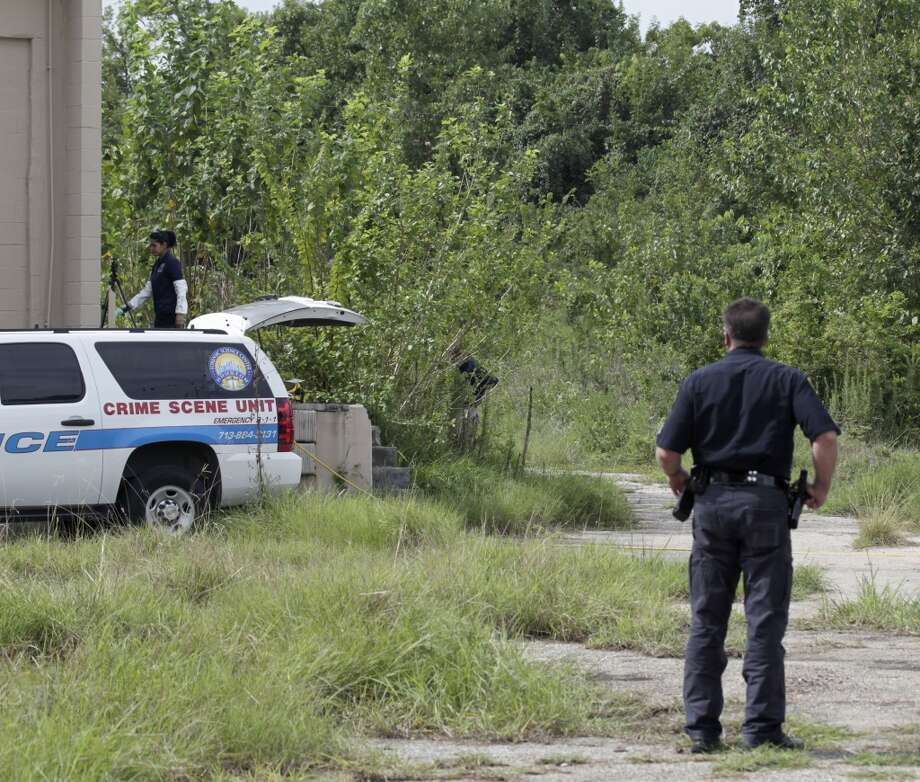 Houston Police Department officers and the Harris County Medical Examiners Office investigate at the scene where the remains from three people have been found in the 10700 Todd street Wednesday, Sept. 9, 2015, in Houston. Police have charges Jamie Walter with capital murder in the case.  ( James Nielsen / Houston Chronicle ) Photo: Houston Chronicle
