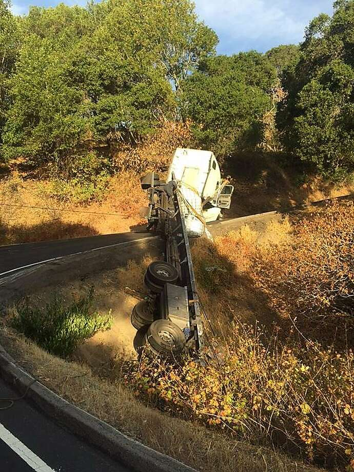 A big-rig overturned in rural Marin County, spilling an estimated 300 gallons of paint, officials said. Photo: CHP Marin