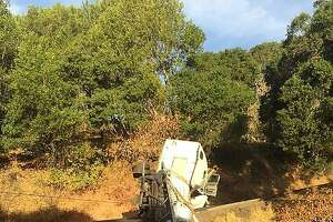 A big-rig overturned in rural Marin County, spilling an estimated 300 gallons of paint, officials said.