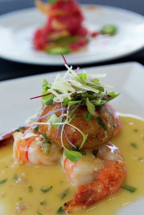 The shrimp scampi appetier, foreground, and the ahi tuna tartare, background, are two light and flavor-filled starters at Neiman Marcus' Mariposa restaurant. Photo: William Luther /San Antonio Express-News / © 2015 San Antonio Express-News