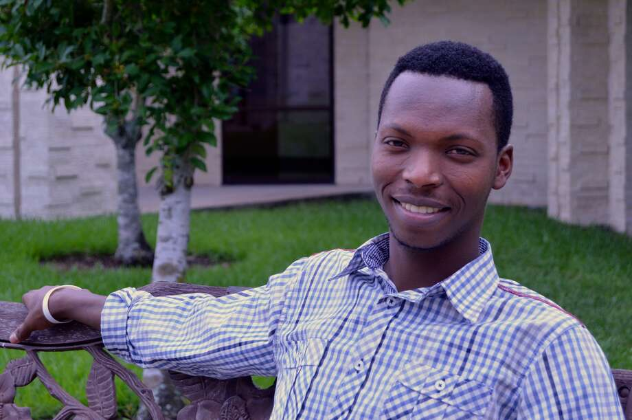 As a child, Jeune Ruhumuriza, a Tutsi, fled a 2004 massacre in Burundi. At Houston ISD's Liberty High School, he found a way to earn his diploma while working to support his family. Photo: Andrew Kragie / For The Chronicle