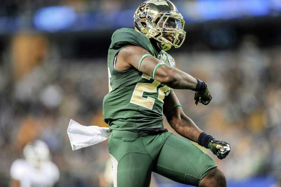 Baylor Bears cornerback Terrence Singleton (24) celebrates after making a tackle against Michigan State during the 79th Goodyear Cotton Bowl Classic at AT&T Stadium Thursday, Jan. 1, 2015, in Arlington, Texas. (Cal Sport Media via AP Images) Photo: Michael Prengler, CTR / CALSP