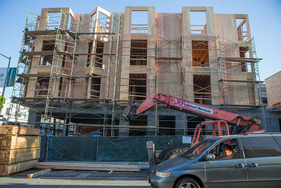 A van passes by a new construction site at Hill and Valencia Streets in the Mission on Wednesday, Sept. 9, 2015 in San Francisco, Calif. Photo: Nathaniel Y. Downes, The Chronicle
