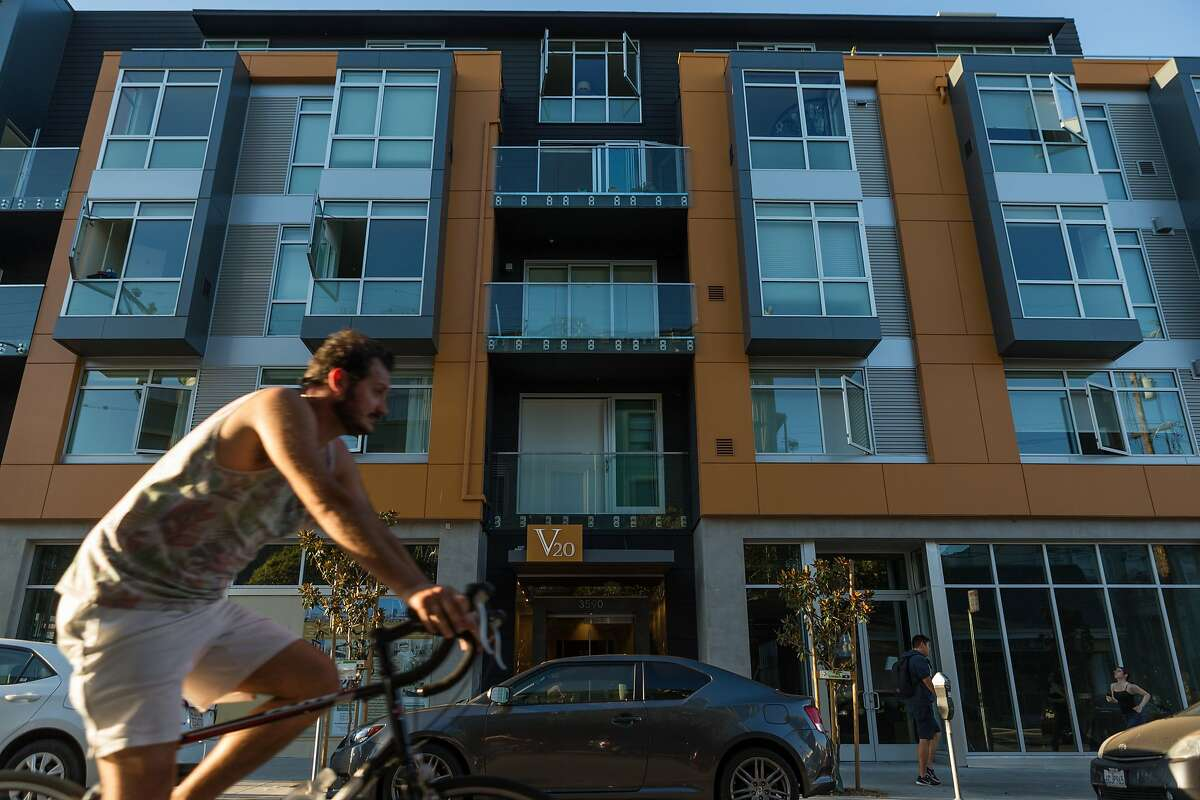 Foot and bicycle traffic pass the new development at 20th and Valencia Streets in the Mission on Wednesday, Sept. 9, 2015 in San Francisco, Calif.