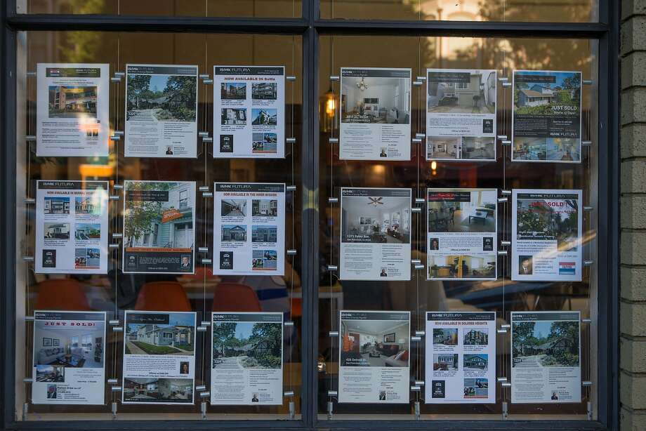 FILE -- A real estate agent on Valencia Street near 20th Street displays homes for sale on Wednesday, Sept. 9, 2015 in San Francisco. A Bay Area couple who recently made the leap to homeowners share a few of their tips for landing a house in this pricy real estate market. Photo: Nathaniel Y. Downes, The Chronicle