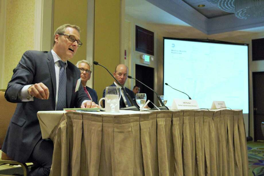 Thomas Wright, President, Regional Plan Association, at left, along with  Jeffrey Parker, Founder and CEO, Parker Infrastructure Partners and Stephen Gallucci, Managing Partner, NY Metropolitan Marketplace, Deloitte, seated at far right, answer questions from attendees on the impact of faster rail service within Connecticut and New York. The Business Council of Fairfield County, NAIOP Commercial Real Estate Development Association of Connecticut and Suburban New York, and Stamford Downtown hosted the ì30 Minutes to Manhattan: What will it take?î breakfast meeting at the Stamford Marriott Hotel in Stamford, Conn. on Sept. 9, 2015. Photo: Matthew Brown / For Hearst Connecticut Media / Connecticut Post Freelance