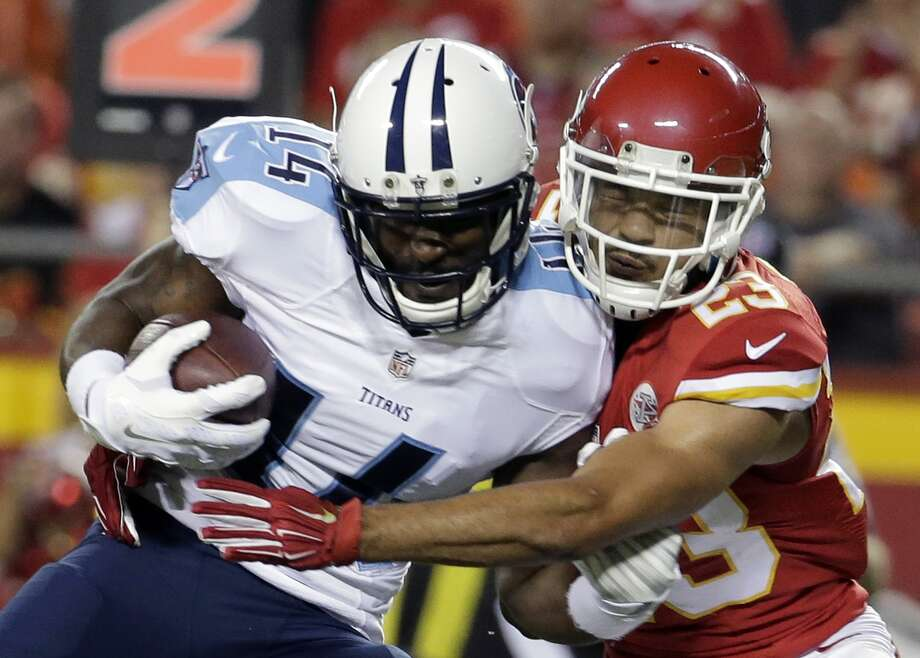 Tennessee Titans wide receiver Hakeem Nicks (14) is tackled by Kansas City Chiefs defensive back Phillip Gaines (23) during the first half of a preseason NFL football game at Arrowhead Stadium in Kansas City, Mo., Friday, Aug. 28, 2015. Photo: Charlie Riedel /Associated Press / AP