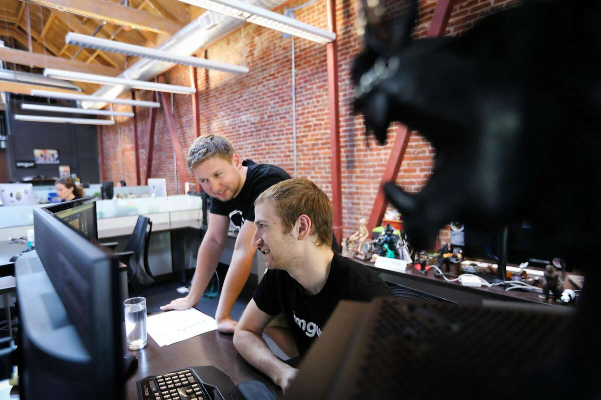 Dan Pastusek (left) and Max Burstein collaborate at Imgur's offices in San Francisco, California, on Wednesday, Sept. 9, 2015.
