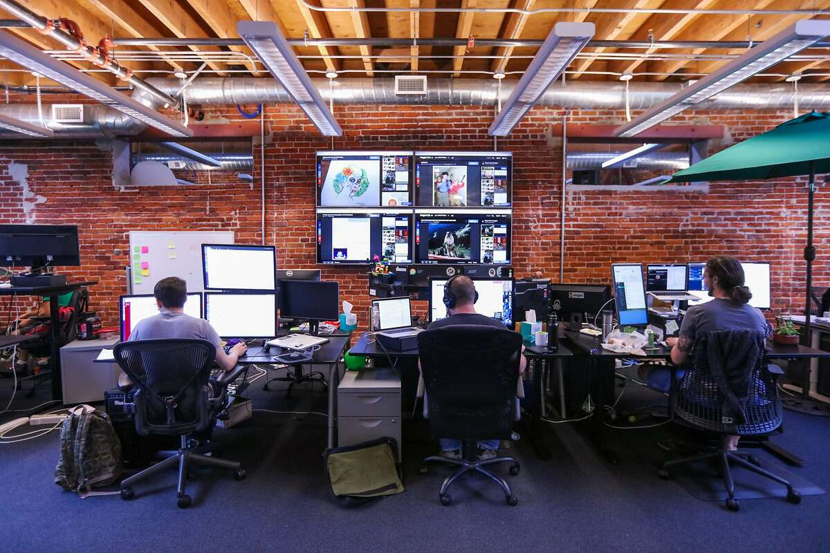 Andy Sacher (right) and his other colleagues work at their desks, at Imgur's office in San Francisco, California, on Wednesday, Sept. 9, 2015.