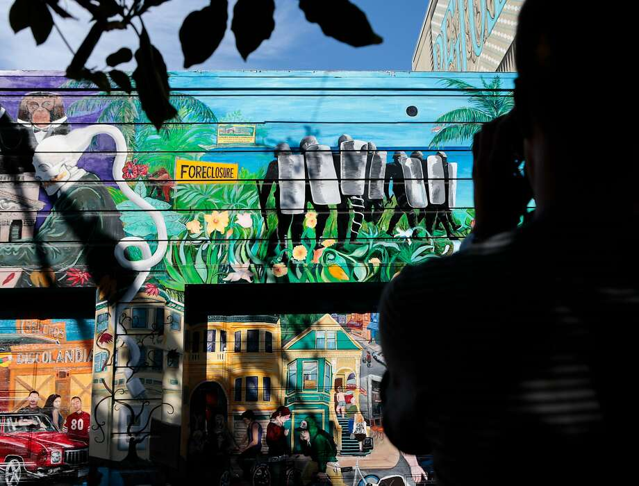 A visitor takes a photo of a Balmy Alley mural on Thursday, Sept. 10, 2015 in San Francisco, Calif. Photo: Nathaniel Y. Downes, The Chronicle