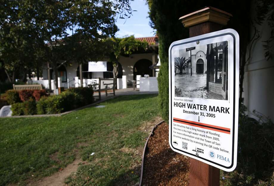 A sign posted in front of the Town Hall in San Anselmo, Calif. on Thursday, Sept. 10, 2015 indicates the high water mark from the last major flood in 2005. San Anselmo Creek has crested well above the 13-foot flood stage at least twice since 1982 and national weather forecasters are predicting significant El Nino conditions this winter. Photo: Paul Chinn, The Chronicle