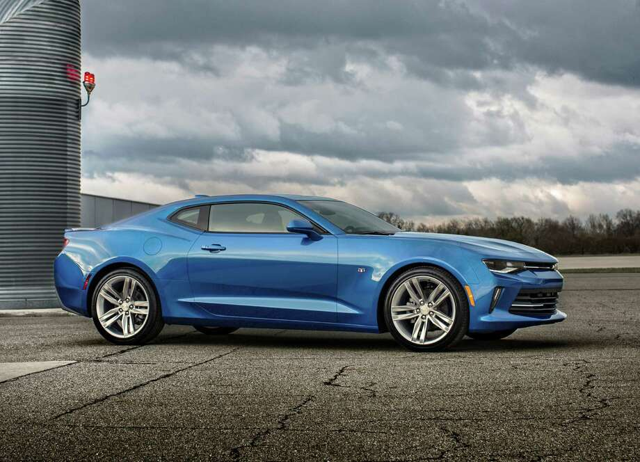 The 2016 Camaro RS package will come with 20-inch gray-painted wheels with 245/40R20 run-flat tires, high intensity discharge headlamps, LED taillights, RS-specific grilles and decklid-mounted lip spoiler. Photo: Chevy / ROCHE PHOTO