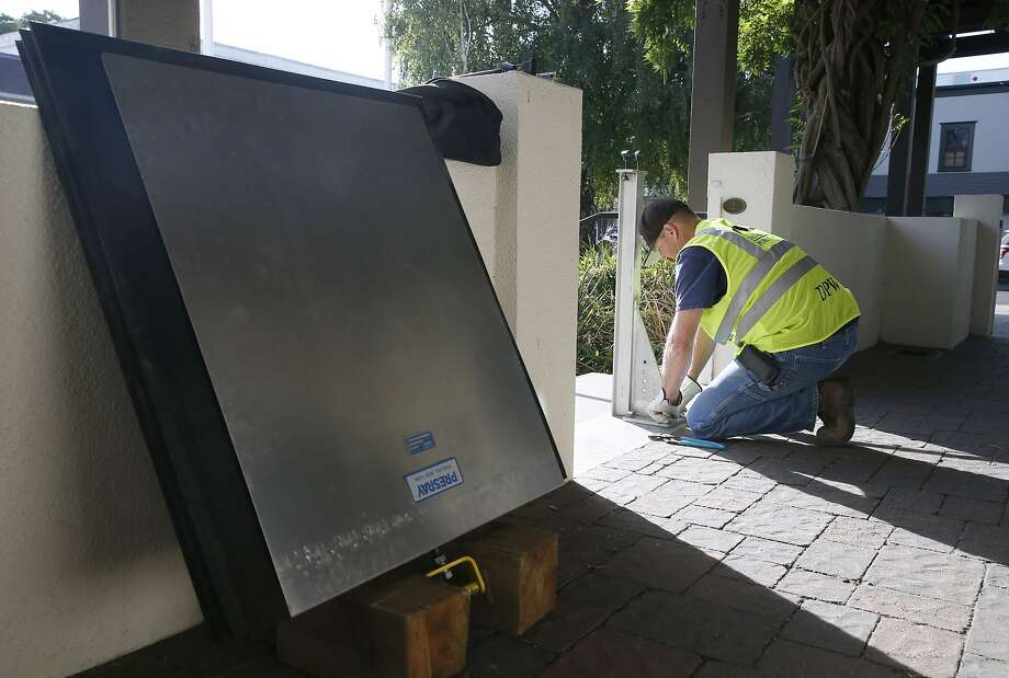 Rob Johnstone, from the Public Works Department, tests flood gates in San Anselmo, Calif. on Thursday, Sept. 10, 2015 that would protect the Town Hall during a heavy flood event. Town officials would install the gates when the flood level reaches 10-feet as a precaution. San Anselmo Creek has crested well above the 13-foot flood stage at least twice since 1982 and national weather forecasters are predicting significant El Nino conditions this winter. Photo: Paul Chinn, The Chronicle