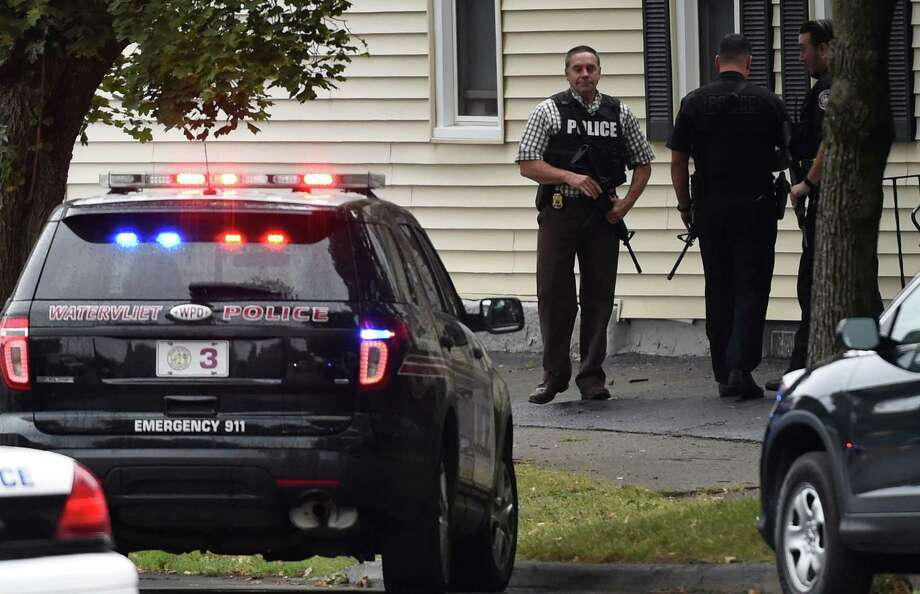 Armed members of various police agencies wait for the Troy Police Tactical Unit to search a building at 28 Andrewsville Court Thursday afternoon Sept. 10, 2015 in Watervliet, N.Y.     (Skip Dickstein/Times Union) Photo: SKIP DICKSTEIN