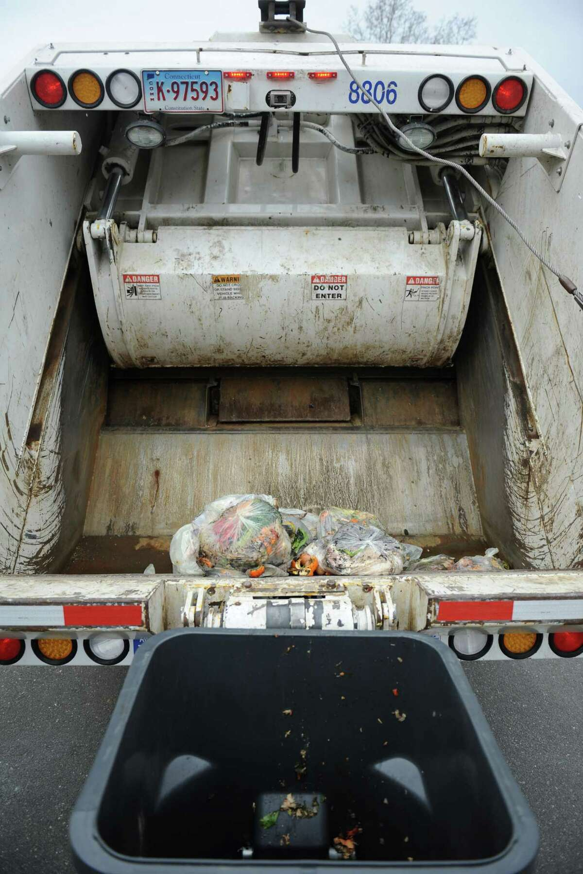 Organic waste is dumped into a truck during the kick-off of the Curbside Organic Pilot Program at The Burnham School in Bridgewater, Conn. Friday, April 4, 2014. The school, in cooperation with All American Waste and the Housatonic Resources Recovery Authority, began the first program of its kind in the state in 2014.