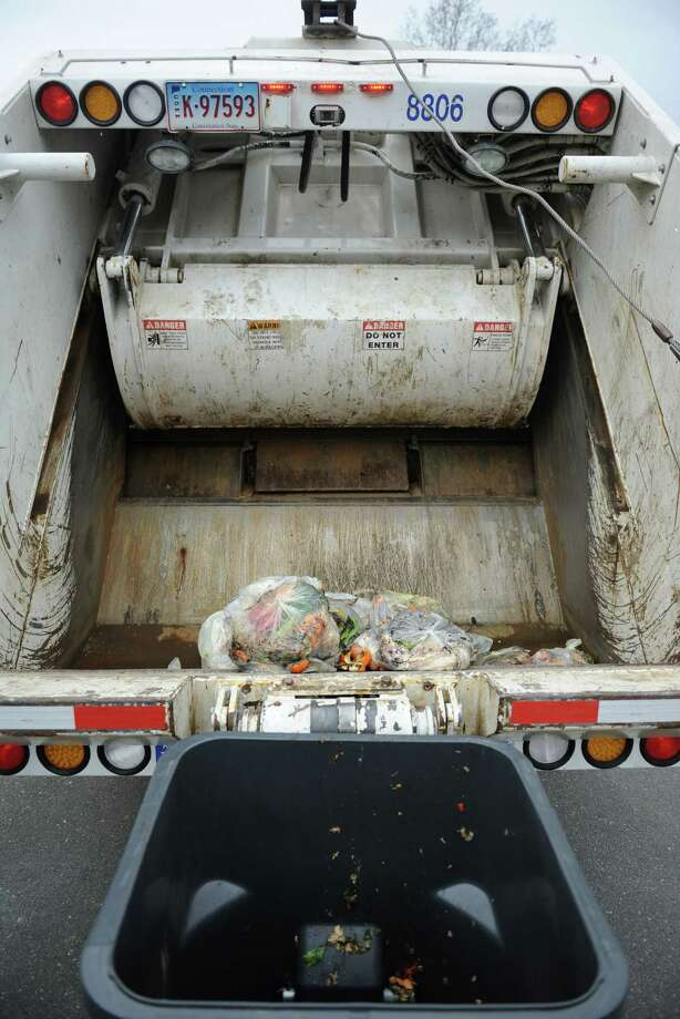 Organic waste is dumped into a truck during the kick-off of the Curbside Organic Pilot Program at The Burnham School in Bridgewater, Conn. Friday, April 4, 2014. The school, in cooperation with All American Waste and the Housatonic Resources Recovery Authority, began the first program of its kind in the state in 2014. Photo: Tyler Sizemore / Tyler Sizemore / The News-Times