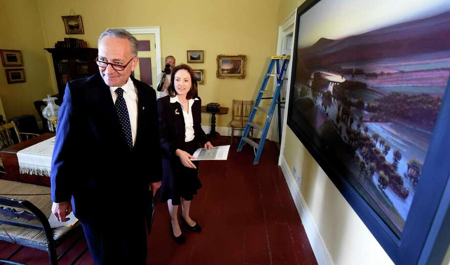 Senator Chuck Schumer is escorted by executive director Betsy Jacks during a visit to the Thomas Cole House Wednesday morning July 1, 2015,   in Catskill, N.Y. Sen.Schumer will use the discovery of two decorative friezes painted by Hudson River landscape painter Thomas Cole to urge the National Endowment for the Humanities to provide funds for late artist's home on Spring Street. The murals were uncovered recently in two of the rooms at Cole's home. Cole painted the friezes in 1836. Authorities said they were covered by common wall paint around 1900. (Skip Dickstein/Times Union) Photo: SKIP DICKSTEIN / 00032462A
