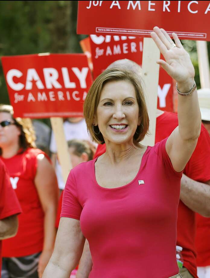 Republican presidential candidate Carly Fiorina, the former Hewlett-Packard chief executive waves as she and supporters march in the Labor Day parade Monday, Sept. 7, 2015, in Milford, N.H. (AP Photo/Jim Cole) Photo: Jim Cole, Associated Press
