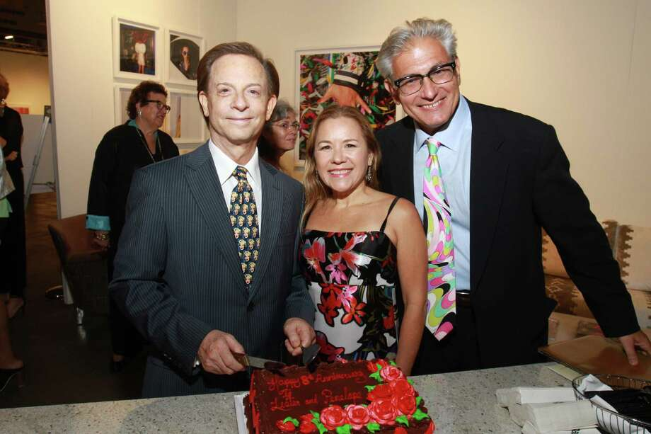Lester Marks and Dr. Penelope Gonzalez Marks, from left, with Rick Friedman at the Houston Fine Art Fair at NRG Center. The cake was for the Marks, who were celebrating their anniversary. Friedman is founder and executive director of the HFAF. Photo: Gary Fountain, For The Chronicle / Copyright 2015 by Gary Fountain