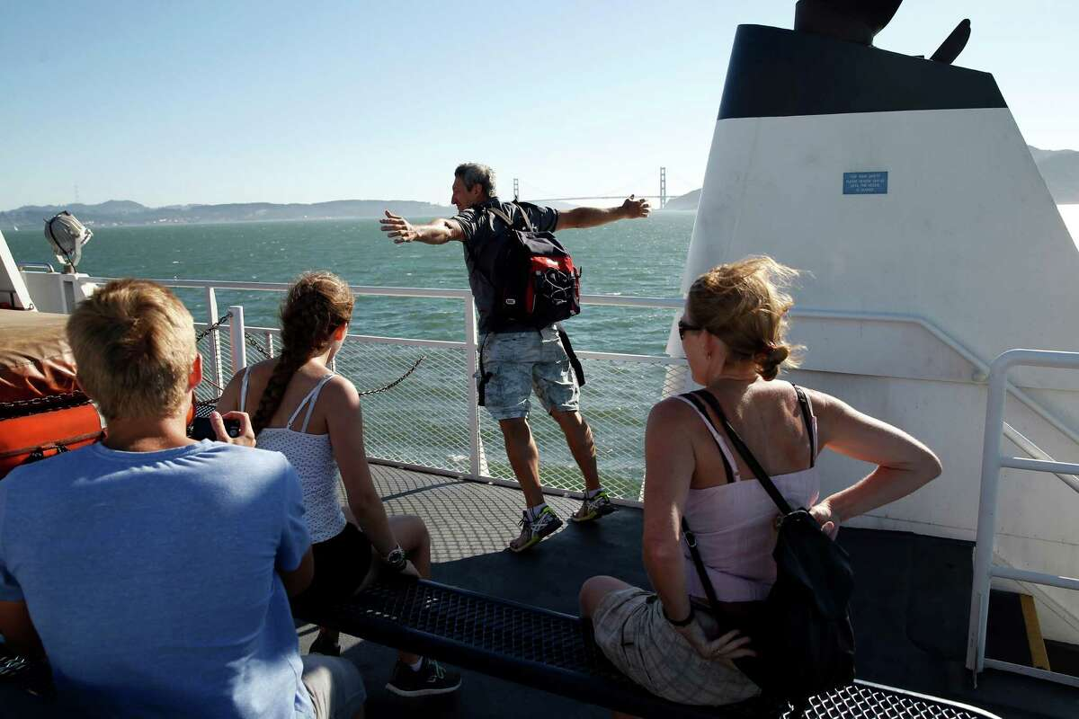 Roland Buehler of Munich feels the wind while riding the Blue and Gold Fleet ferry from Tiburon to San Francisco.
