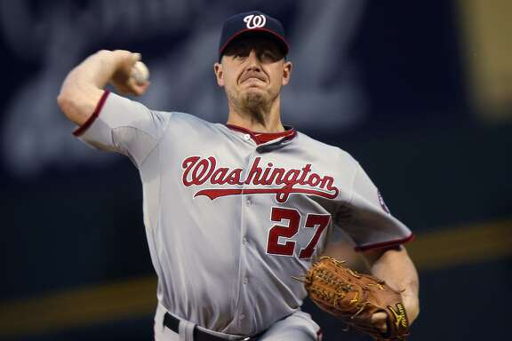 Washington Nationals starting pitcher Jordan Zimmermann throws to a Colorado Rockies batter during the first inning of a baseball game Tuesday, Aug. 18, 2015, in Denver. (AP Photo/David Zalubowski)